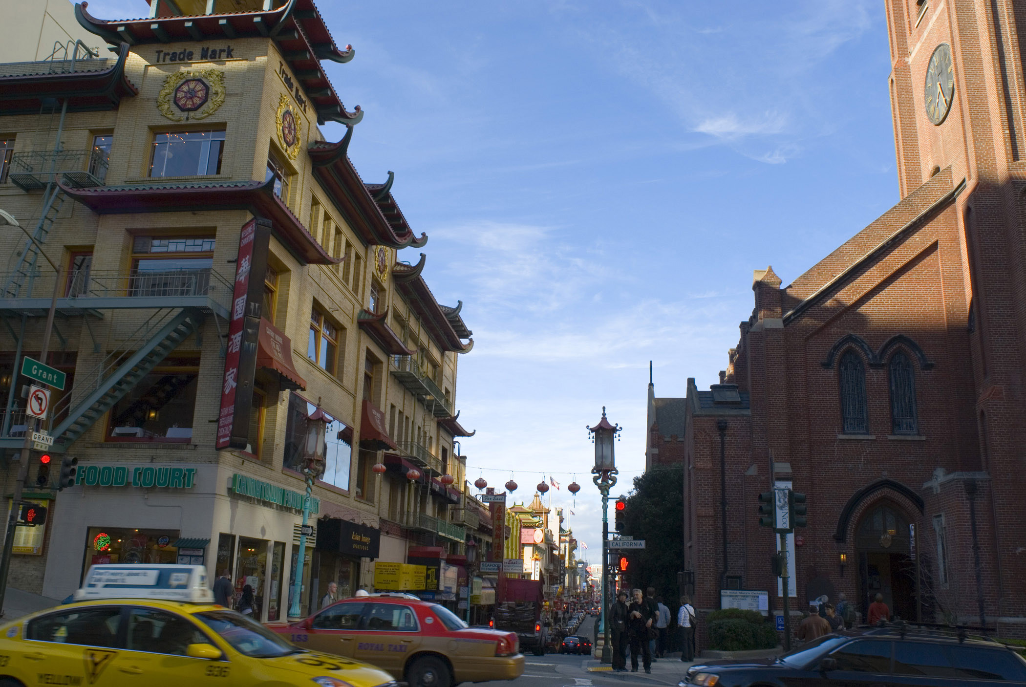 View of a busy street in China Town, San Francisco with traffic, pedestrians, stores and Asian style architecture