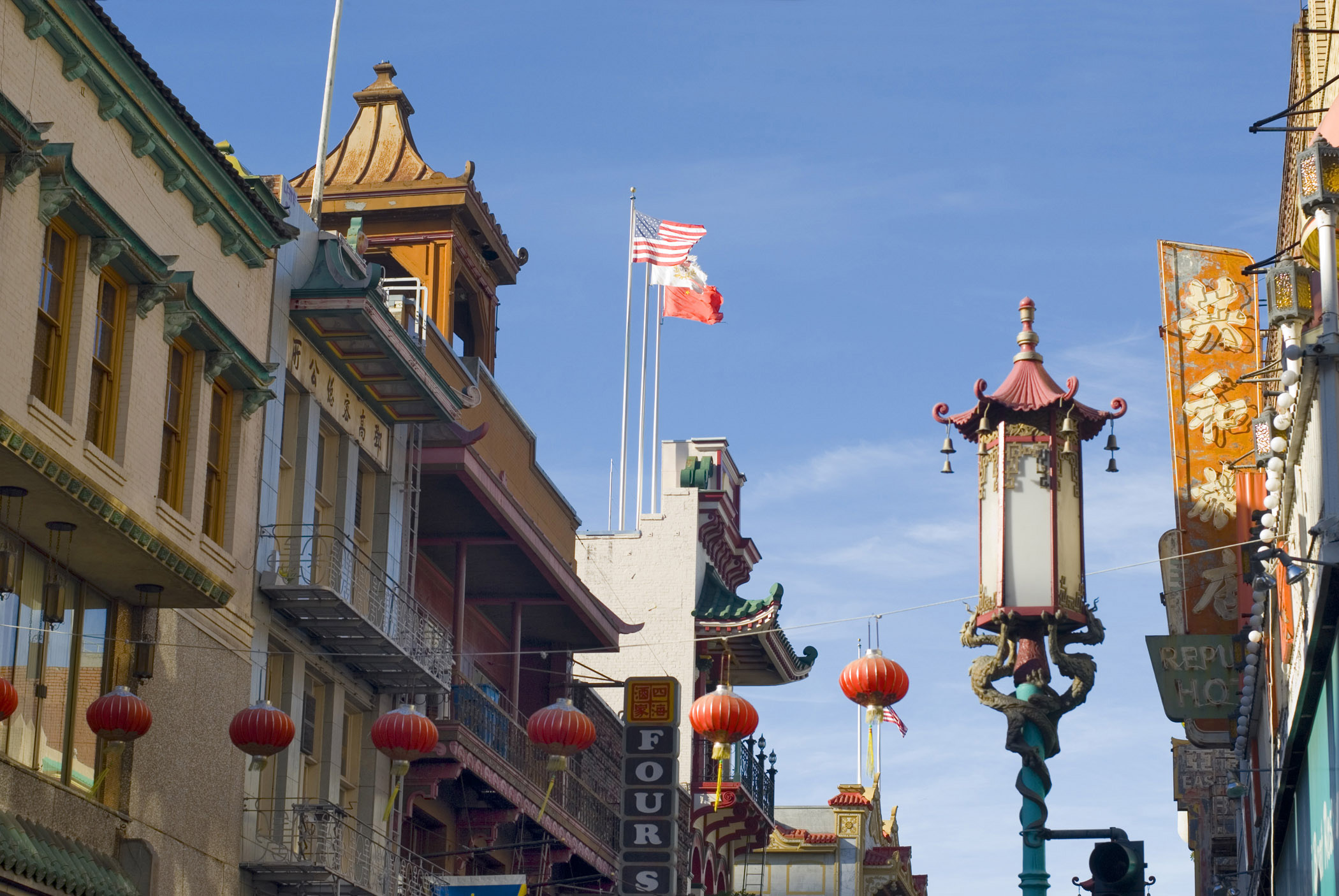 Unique Architectural Buildings at China Town on Lighter Blue Sky Background.