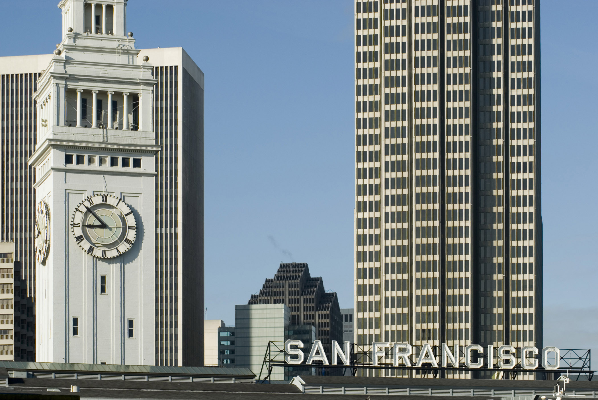 High Rise Architectural Embarcadero Buildings in San Francisco. Isolated on Lighter Gradient Blue Sky Background