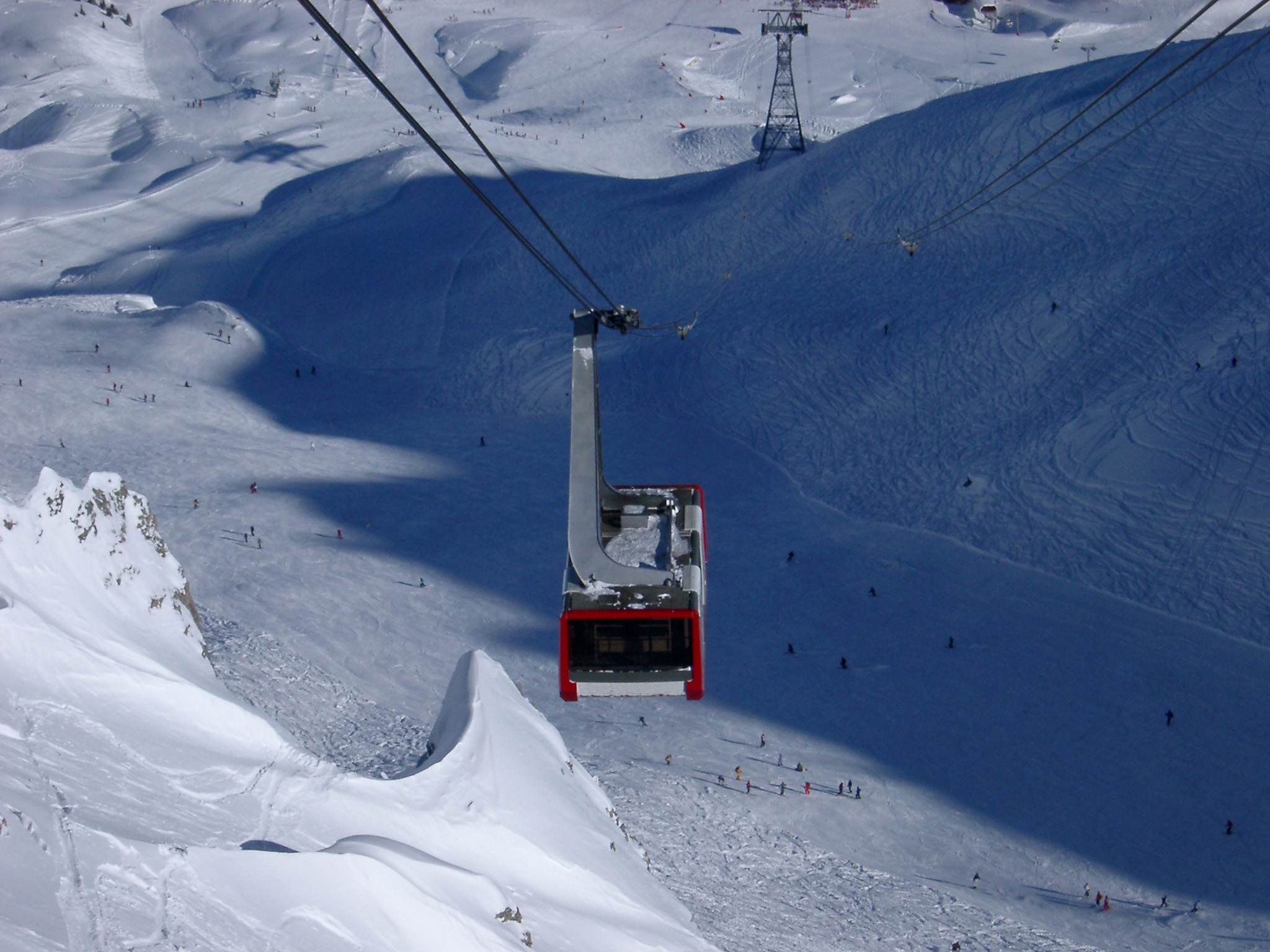 Riding with Cool Cable Car for Adventure Above Snow Field During Winter Season.