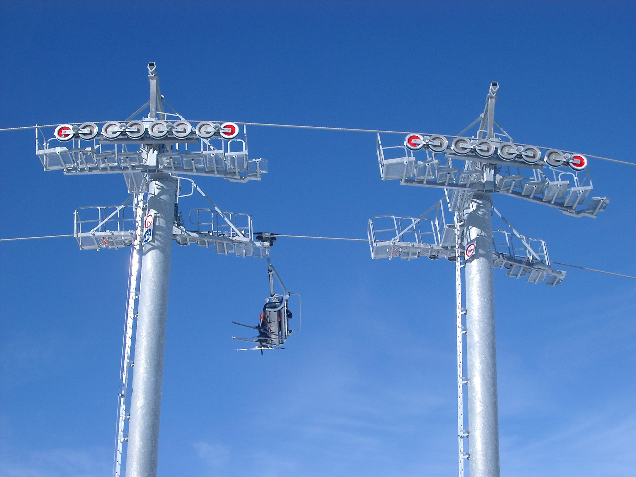 Empty Cable Cars on Light Blue Sky Background.