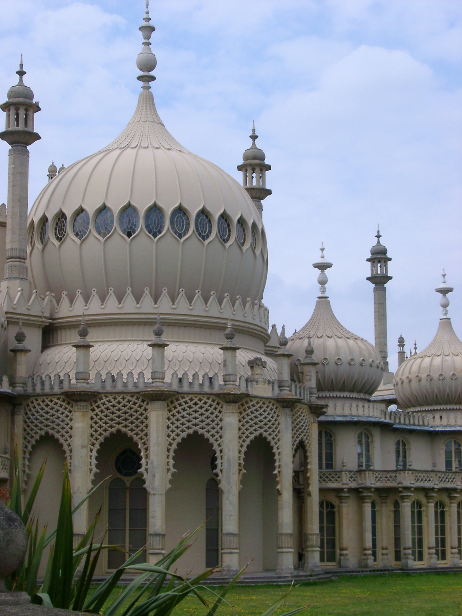 Dome of Famous Royal Pavilion Building on a Grassy Landscape. Located at Brighton, England, United Kingdom.