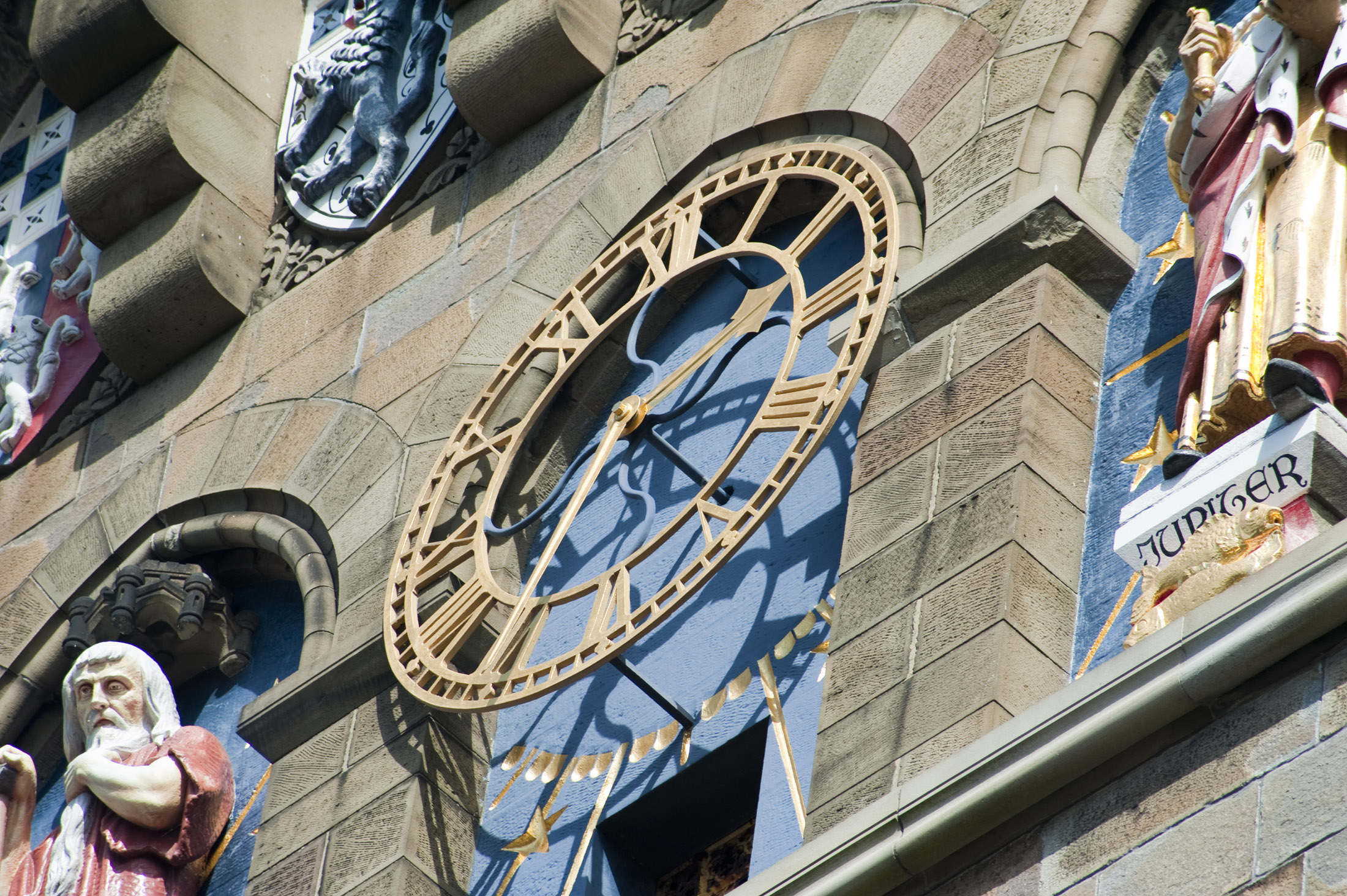 close up on the clock face and statues on cardiff castles clock tower