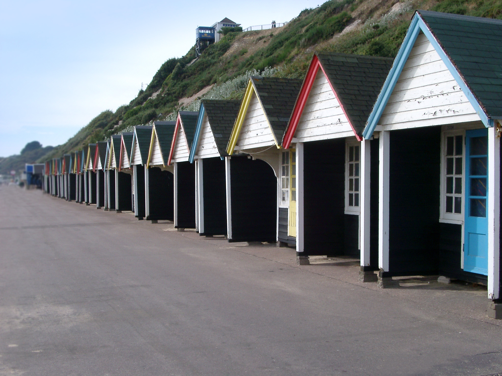 colorful line of beach huts on bournemouths promenade seafont