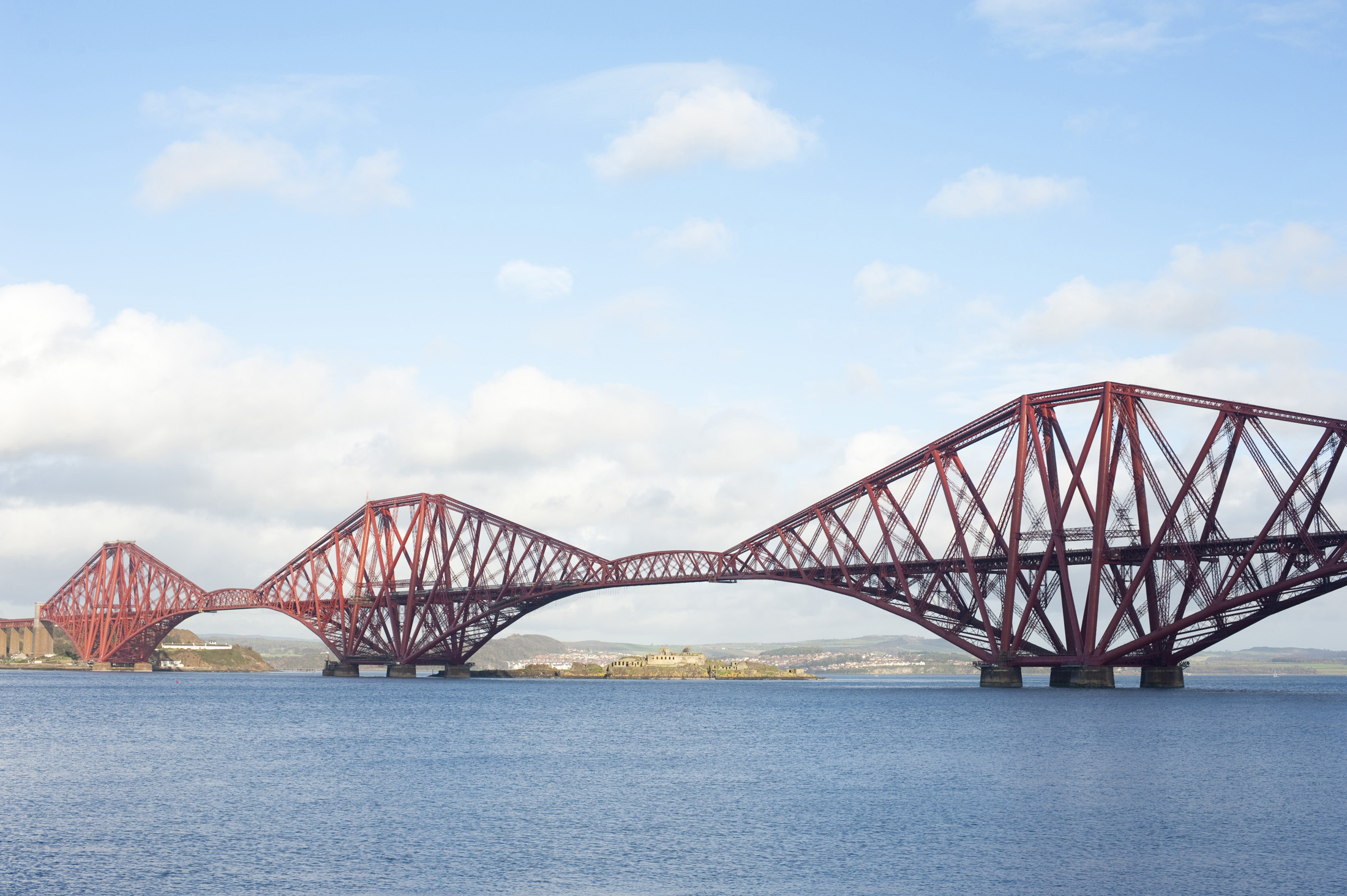 panoramic view of the forth rail bridge crossing the firth of forth, scotland