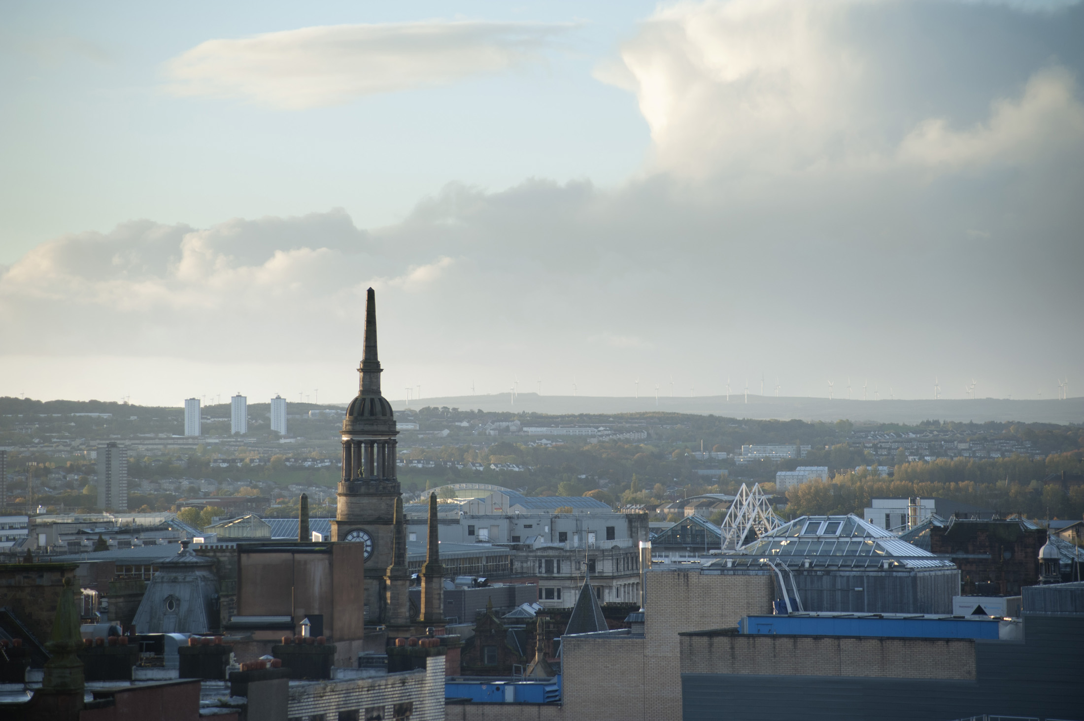 Glasgow skyline with a view across the rooftops of the city on a cloudy day