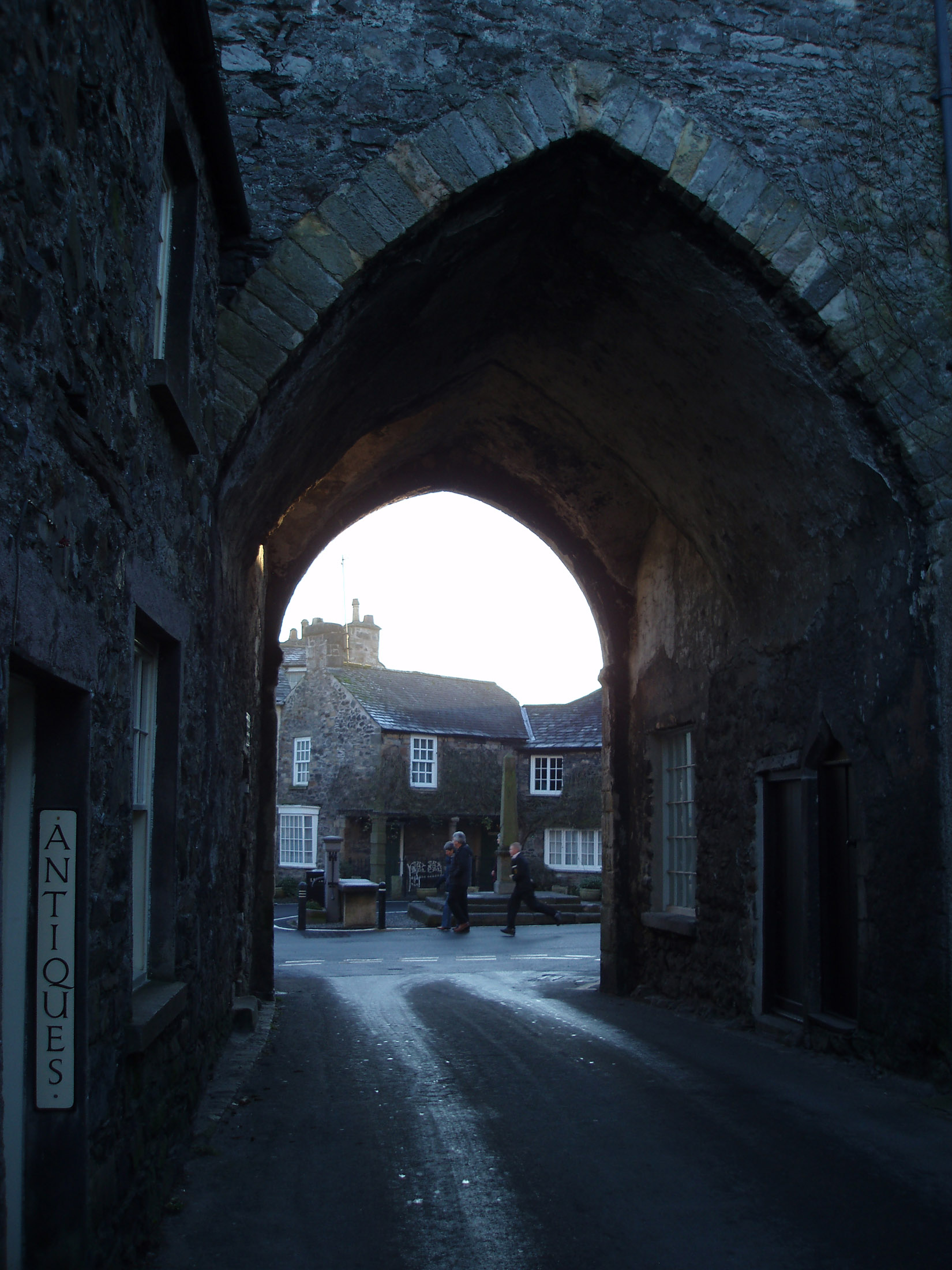 stone arch gatehouse in cartmel village