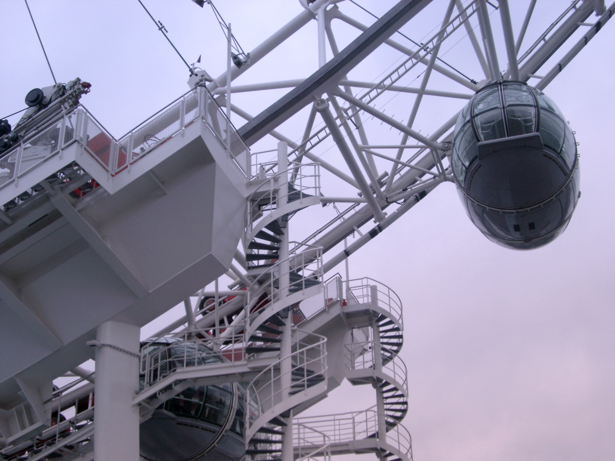 Detail of the London Eye ferris wheel, London showing the boarding platform and ovoid passenger capsule for viewing the topography of the city