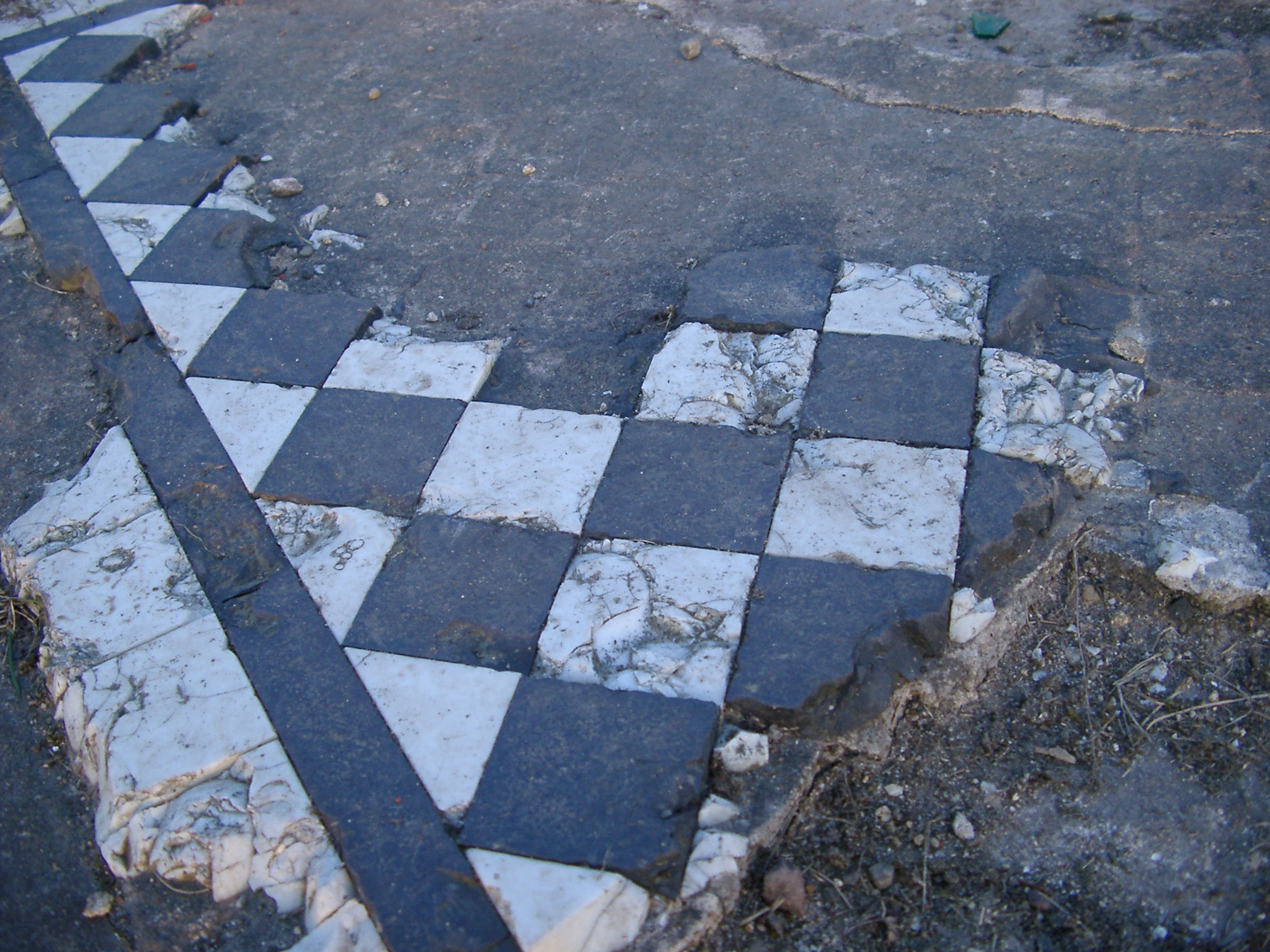 broken tile floor, the remains of the former lever hall that burned to the ground