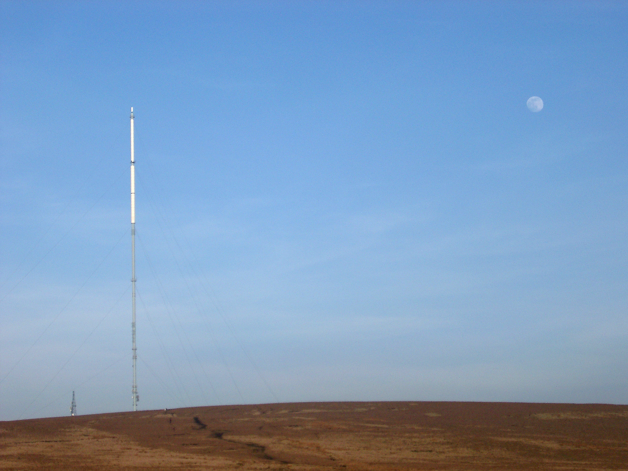 Winter Hill Transmitter on Spacious Landscape of Famous Rivington Pike in Lancashire, England. Captured with Light Blue Sky Background.