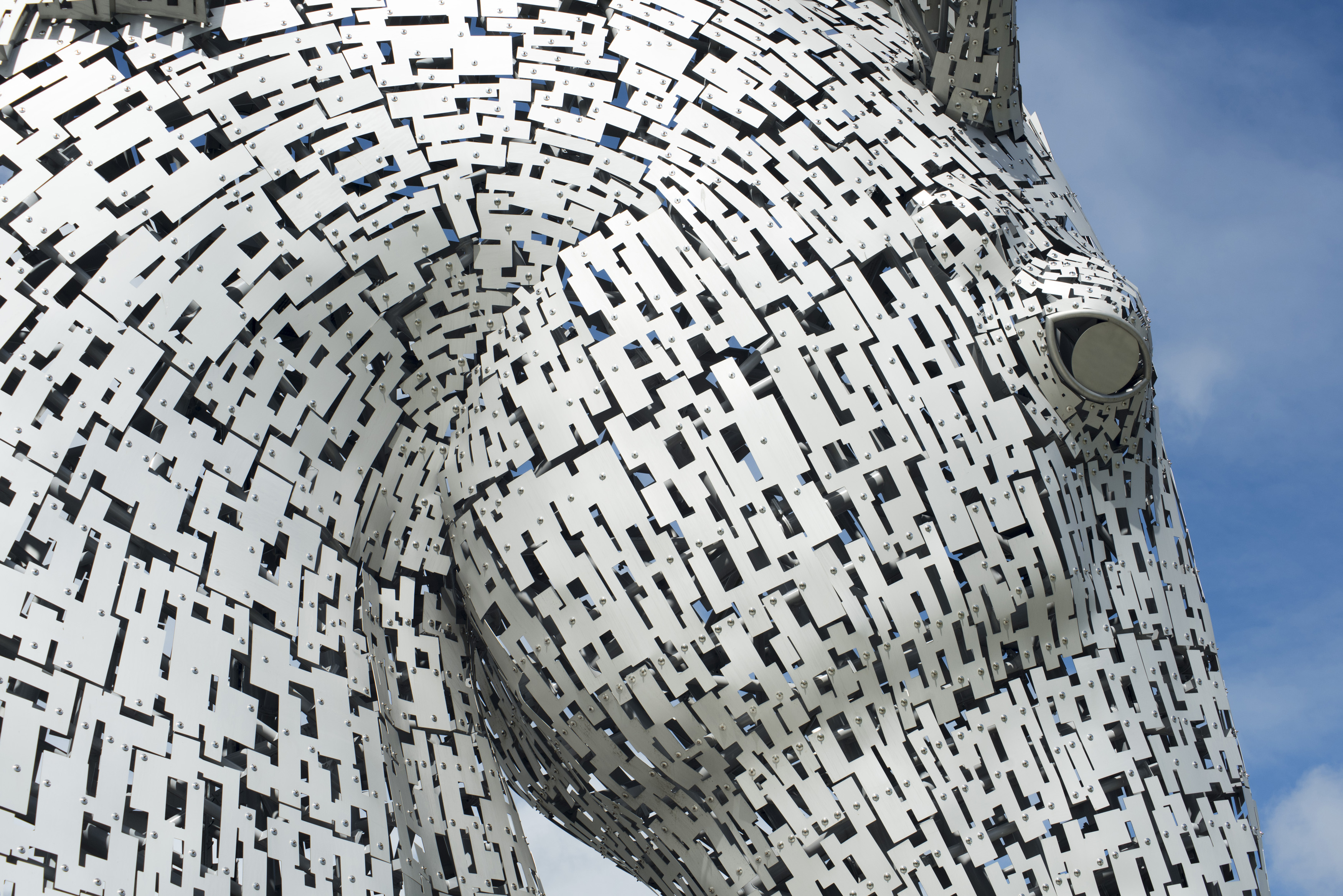 Close up detail of a Kelpies horse statue, Falkirk, Scotland erected to commemorate the role of horses in industry and a popular tourist landmark
