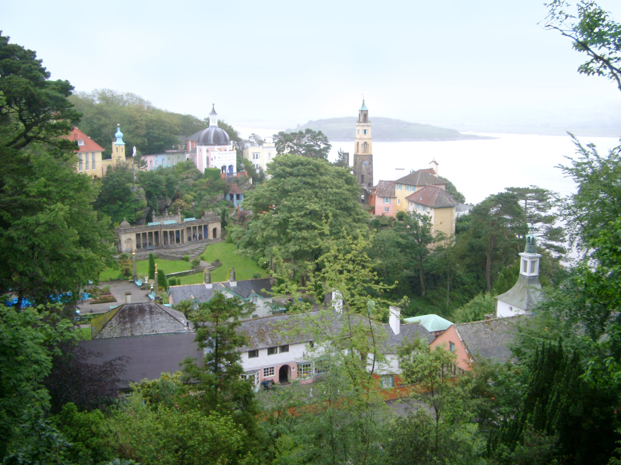 Scenic coastal view of Portmeirion, Gwynedd, Wales, a popular tourist village modelled on an Italian town designed built by Sir Clough Williams-Ellis nestling in lush greenery