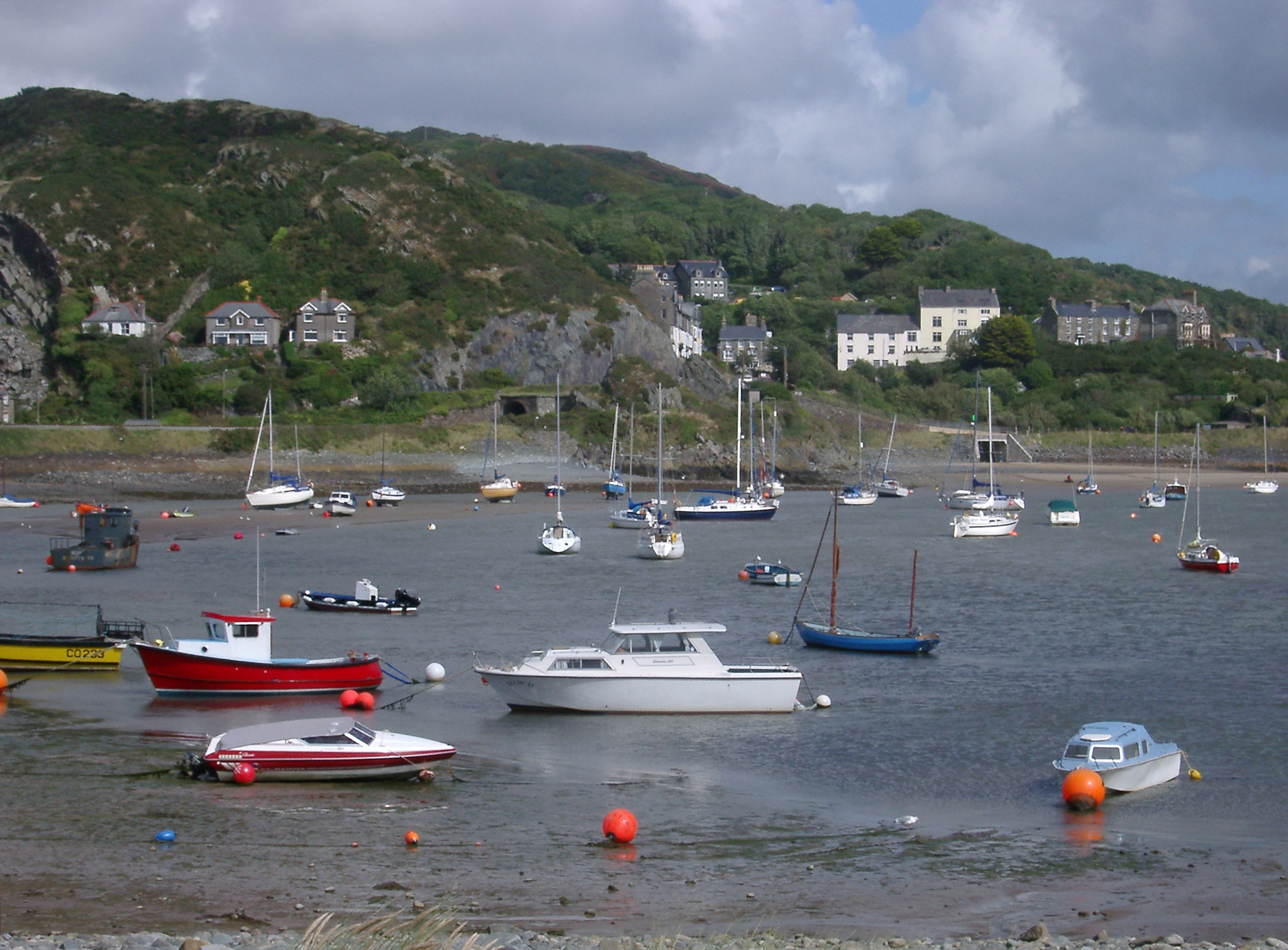Sailboats and Fishing Boats Anchored in Harbor at Low Tide, Barmouth, Gwynedd, Wales
