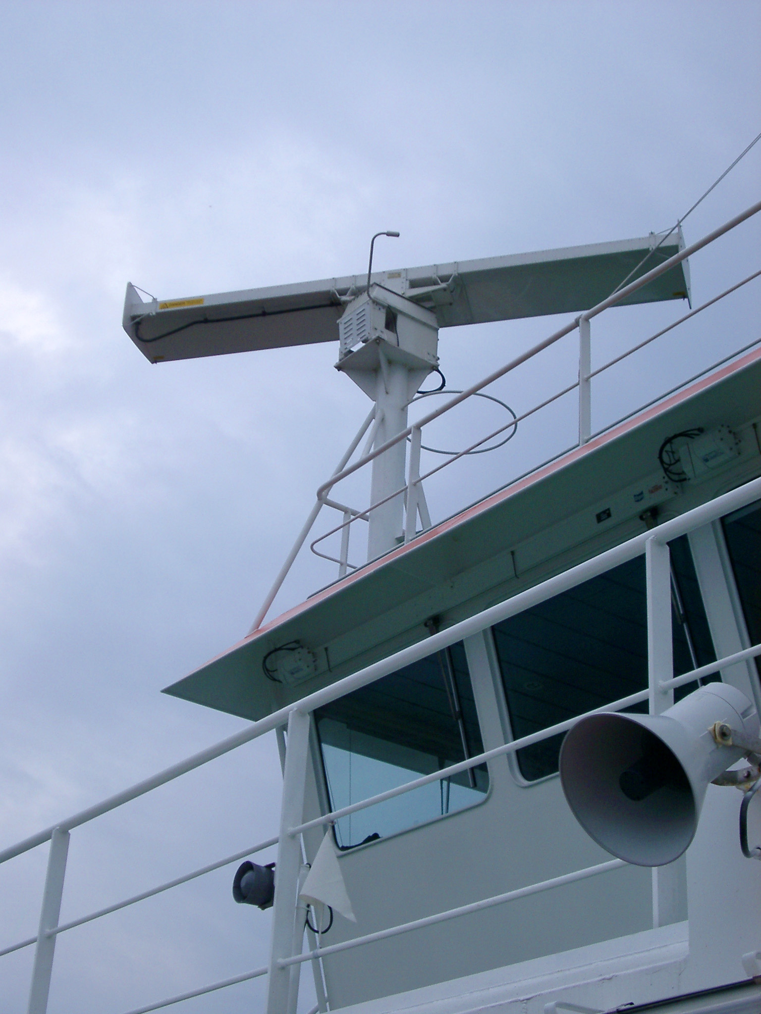 Loud-hailer and radar equipment detail for communication and navigation on a ferry