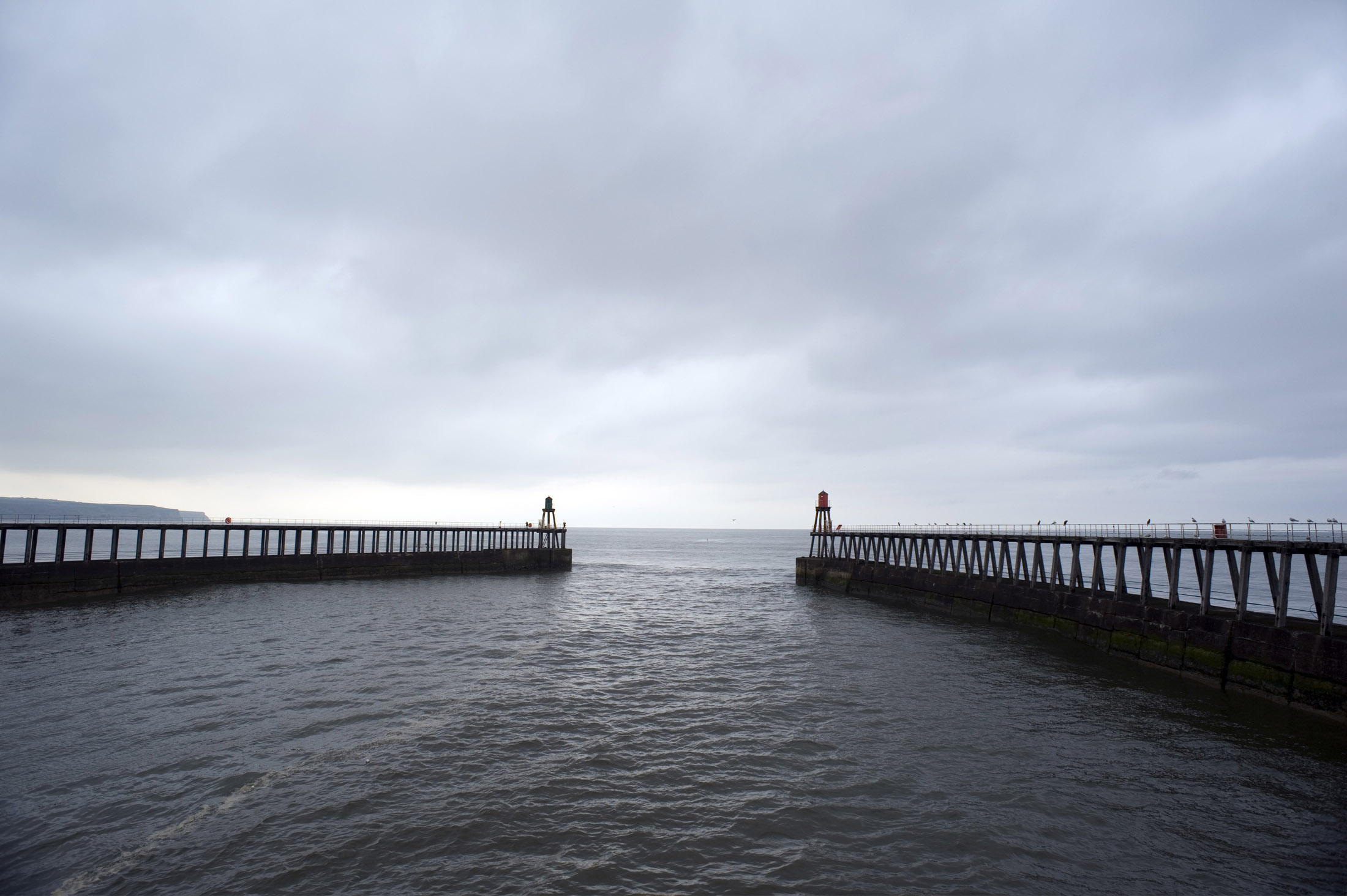the two large breakwaters on the end of the harbour piers at whitby