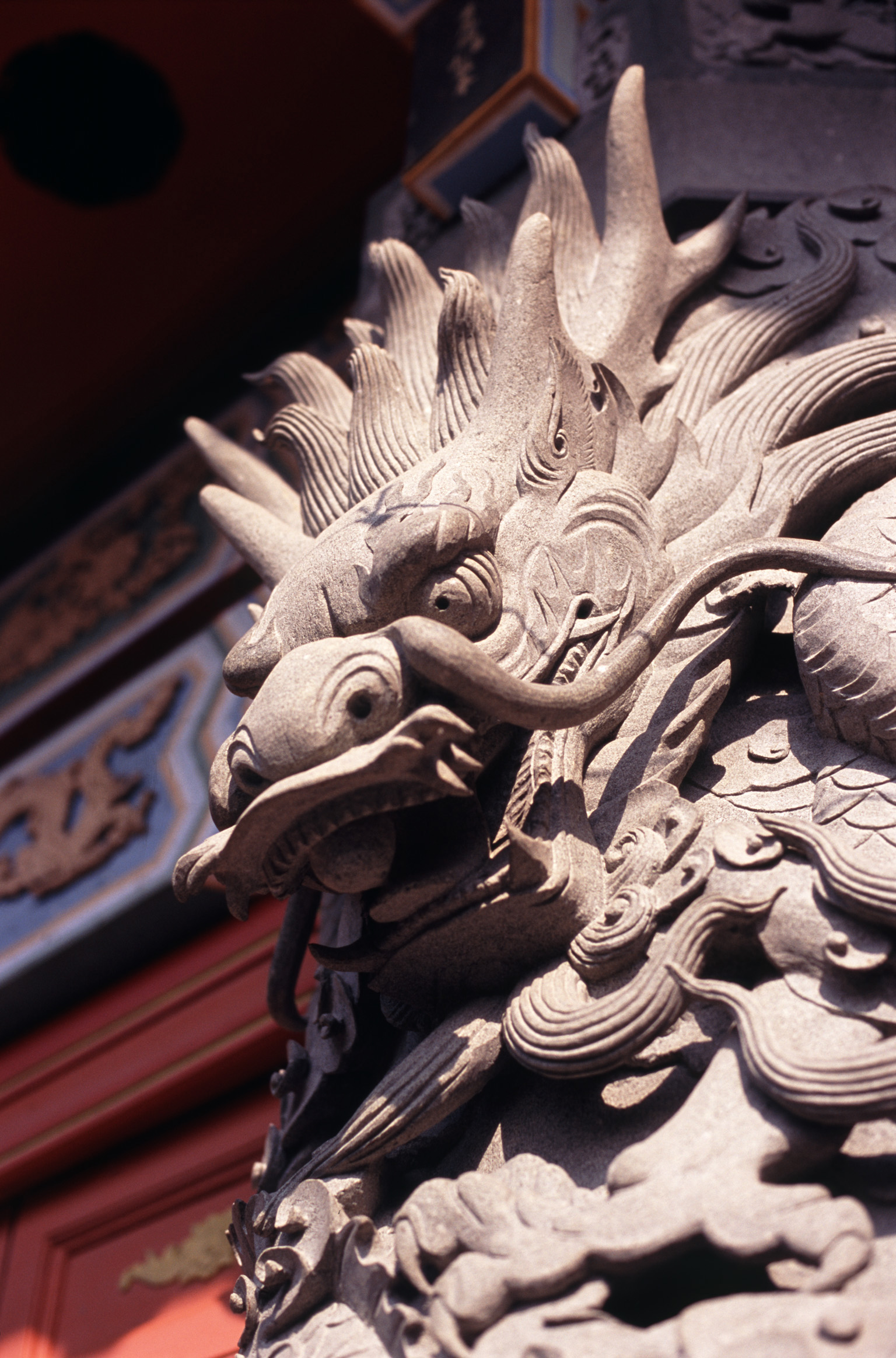 Close up Artistic Vintage Stone Temple Dragon Sculpture in Hong Kong China.