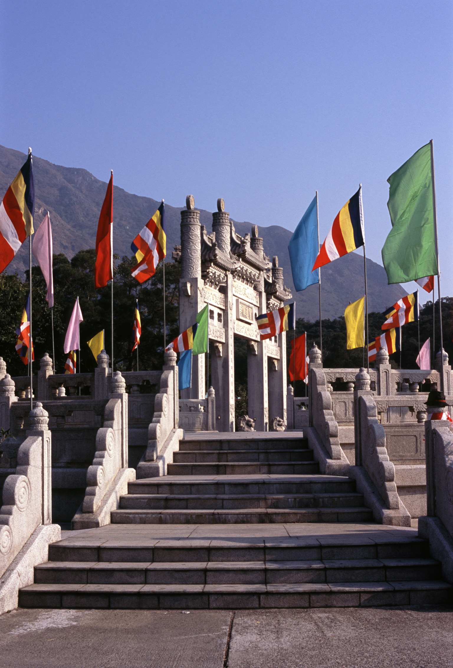 Various Flags on Poles Along the Vintage Pathway of Famous Buddhist Temple in China.