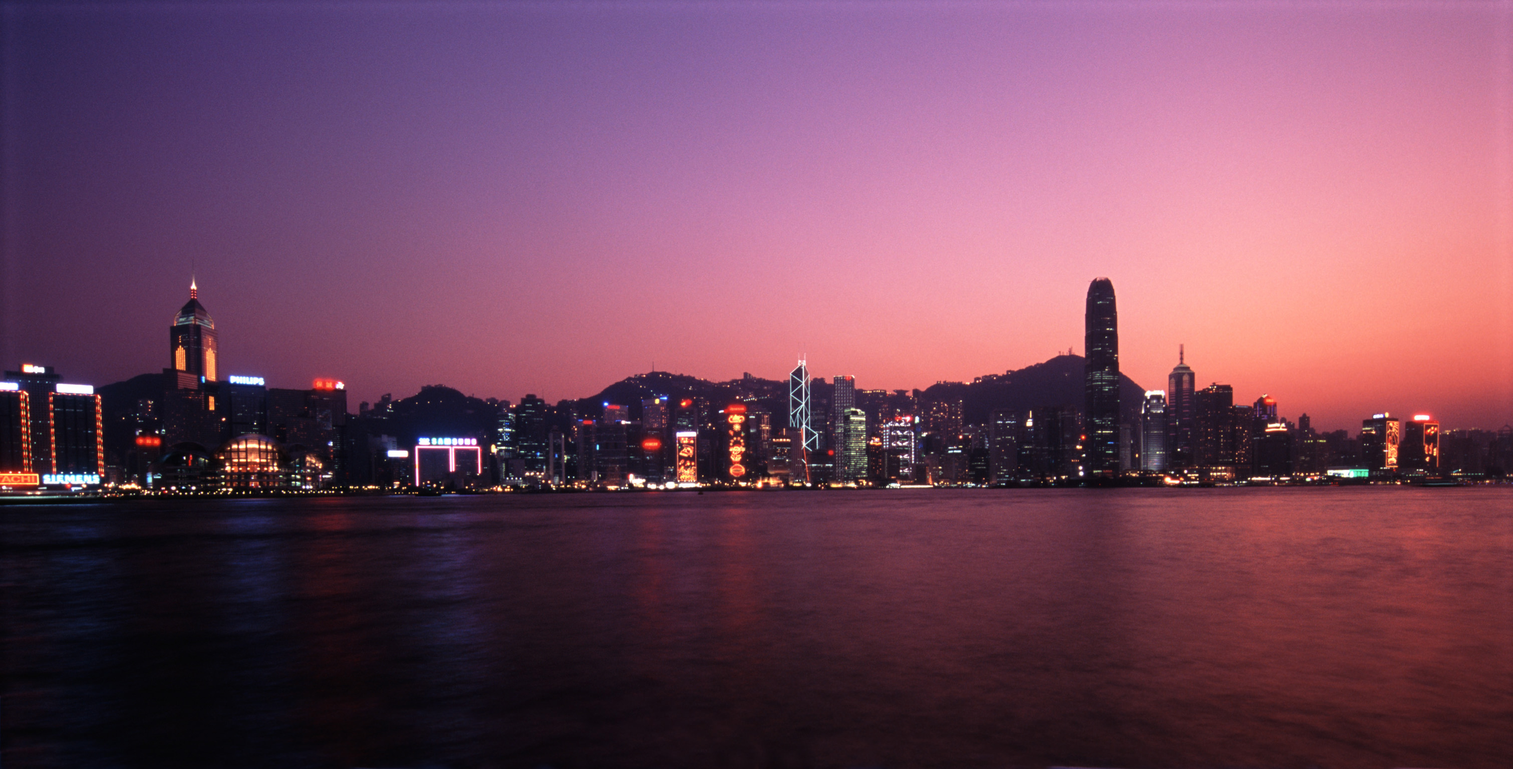 Beautiful Panoramic View of Hong Kong During Night Time. Captured with Architectural Buildings Afar.