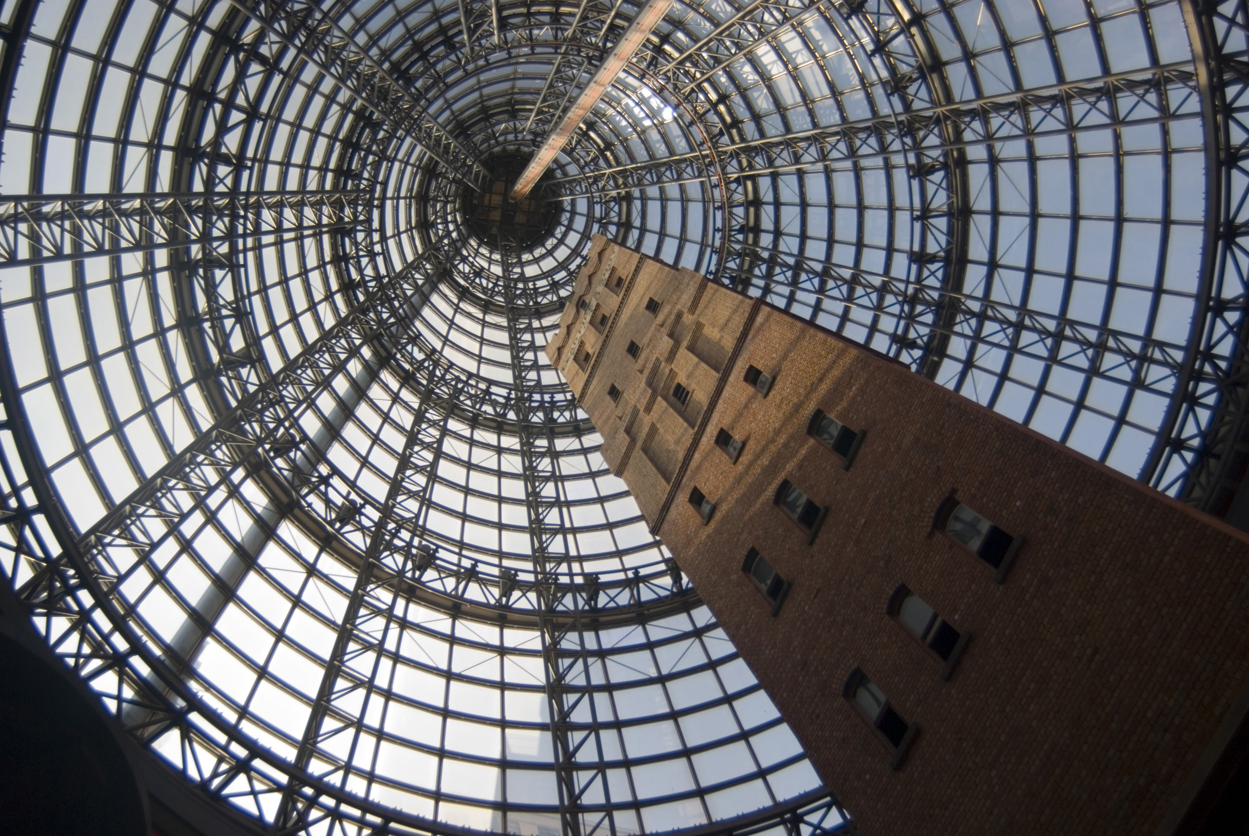 A vertical, mesmerizing view of the glass cone, an architectural masterpiece in Melbourne Central shoppung centre, Australia.