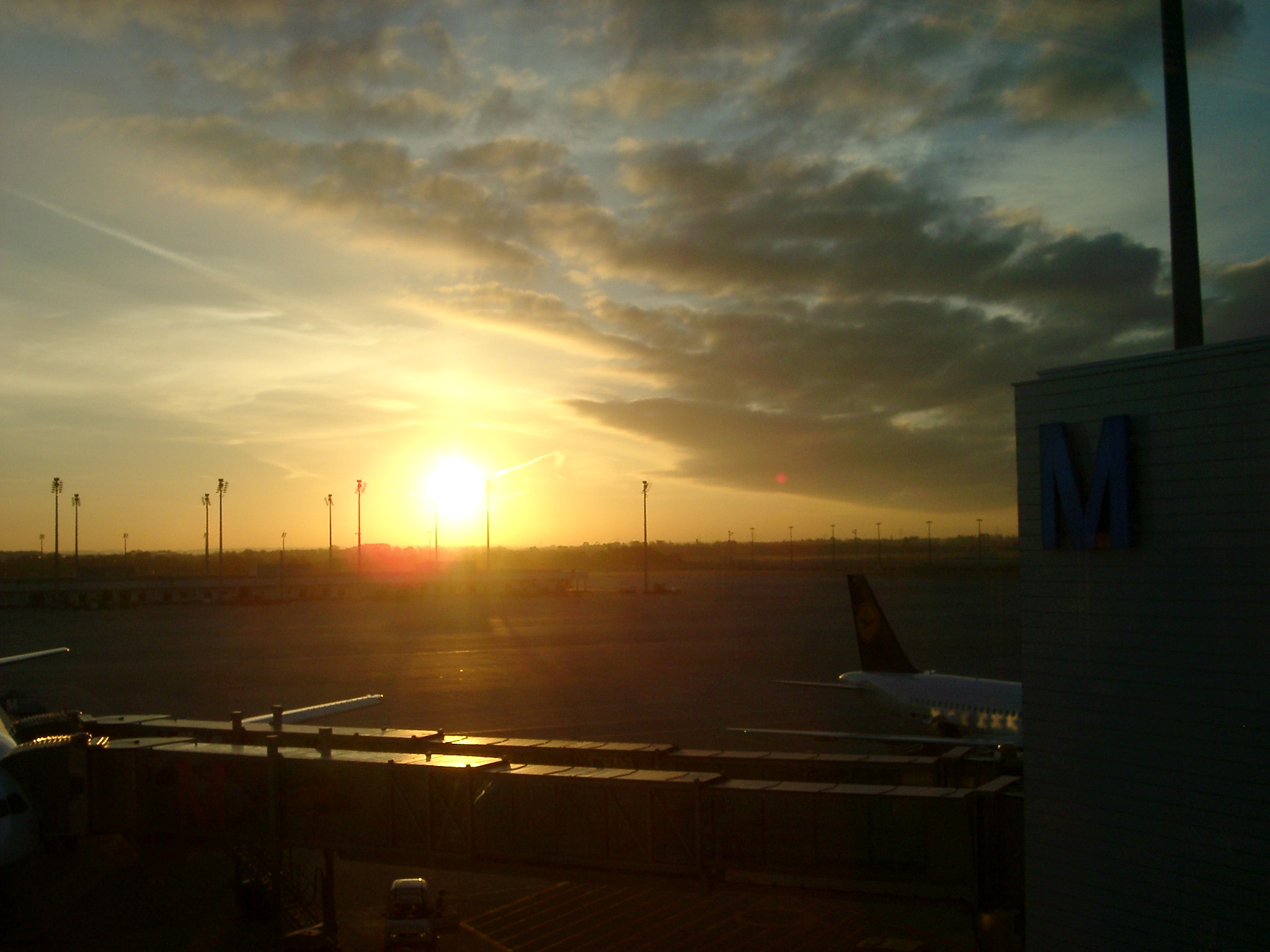 Dramatic Sunrise or Sunset over Airport Tarmac