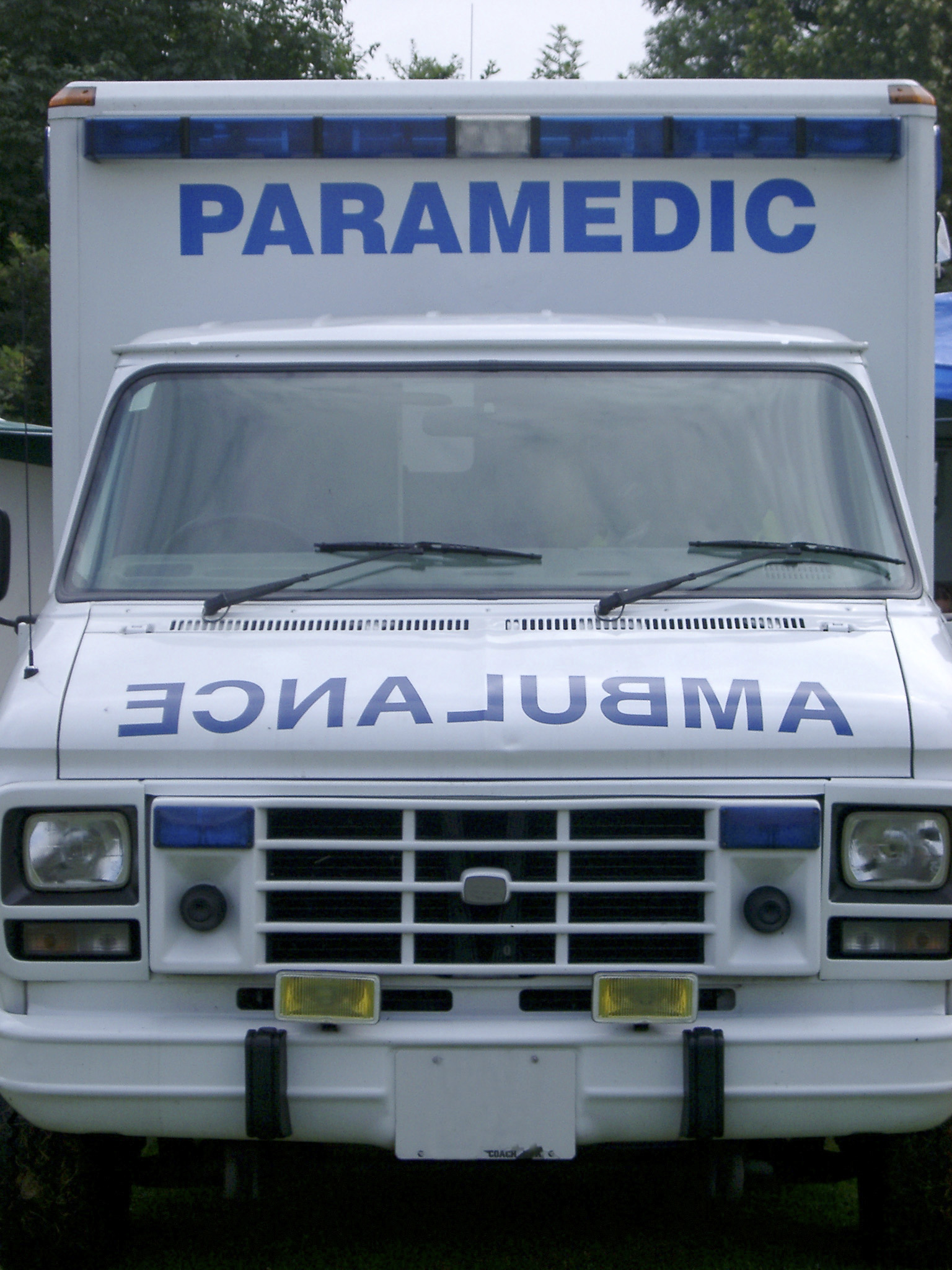 Front close up view of an ambulance with the signage - Ambulance and Paramedic