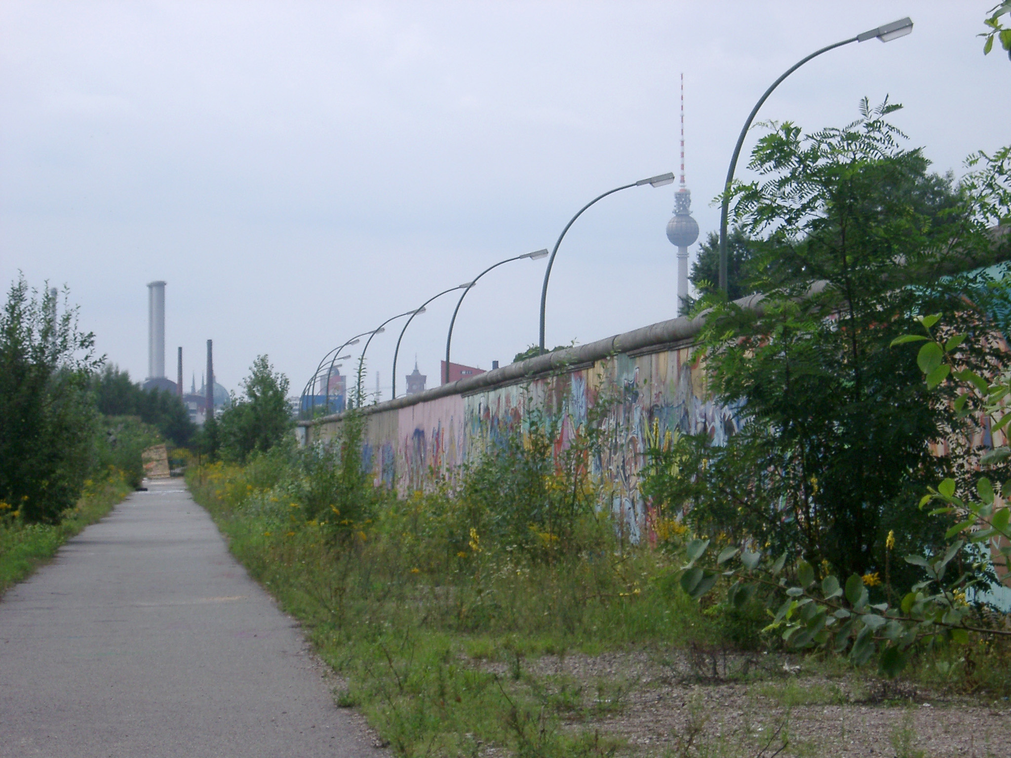 View along a remaining section of the historical Berlin Wall erected by the German Democratic Republic to separate East and West Berlin