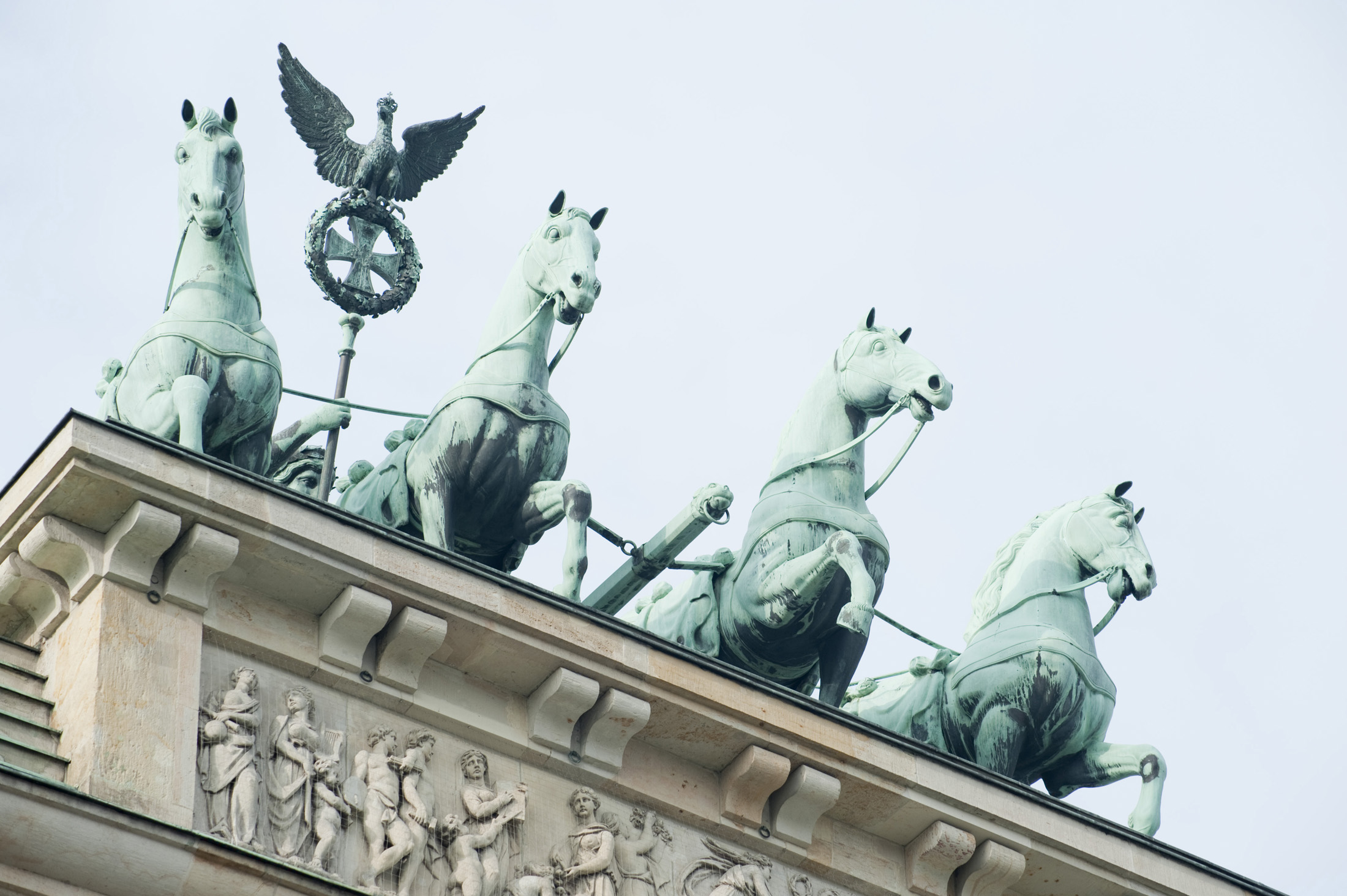 chariot drawn by four horses driven by Victoria, the Roman goddess of victory on top of the Brandenburg gate. Berlin Germany