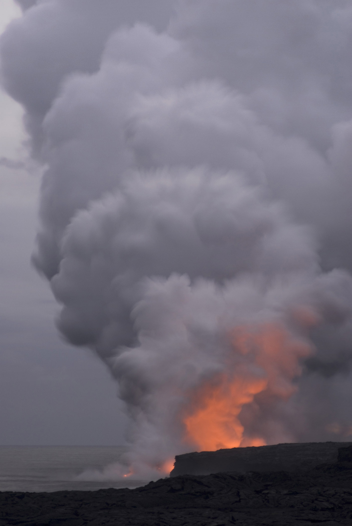 Volcano Spewing Red Hot Lava and Steam on the Coast of Hawaii